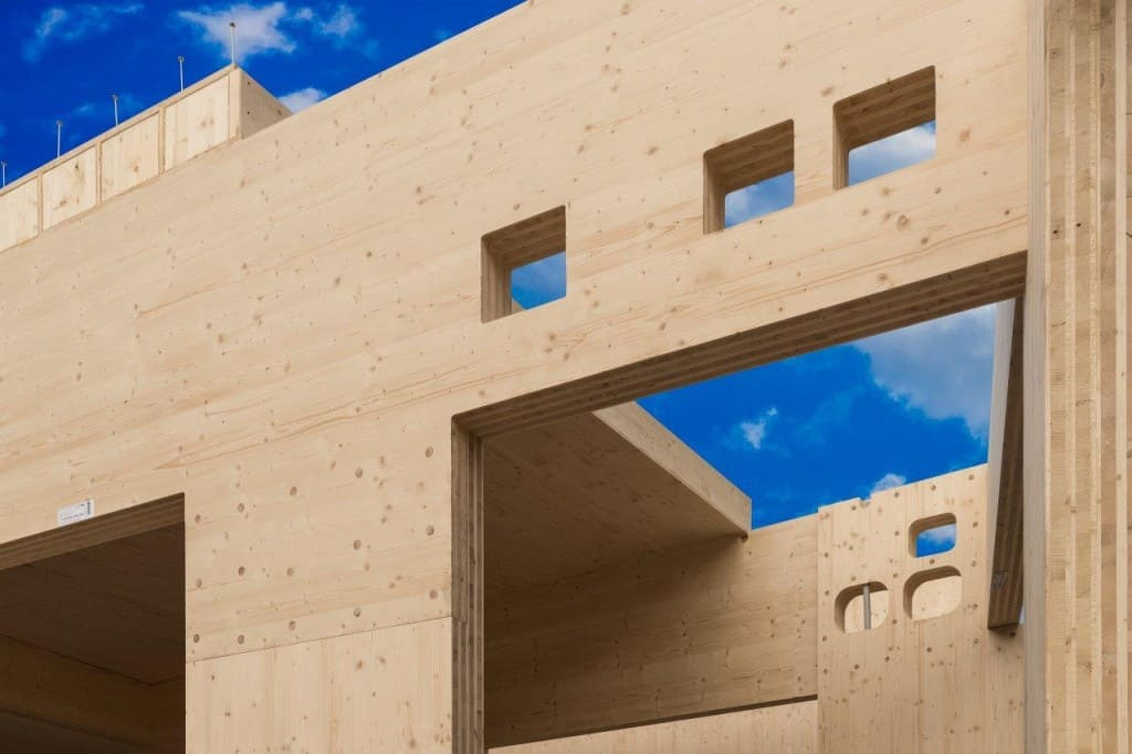 Timber buildings cost less than concrete construction for Panel house construction