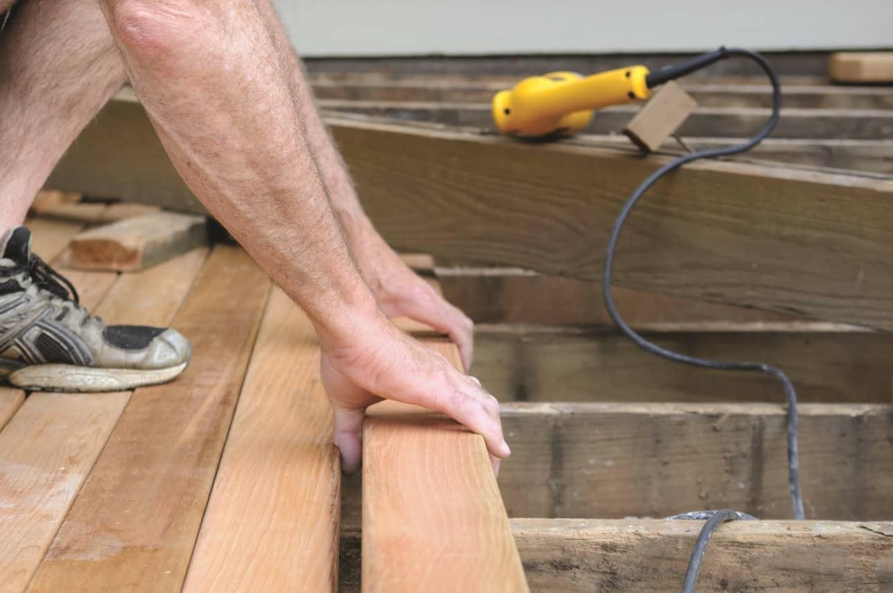 Carpenter installing new wood decking.